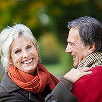 Older woman embracing older man