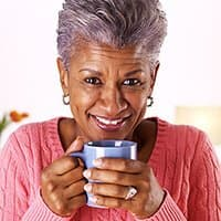 Middle Aged Woman holding cup of coffee