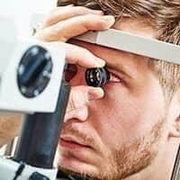 Young man having an eye exam